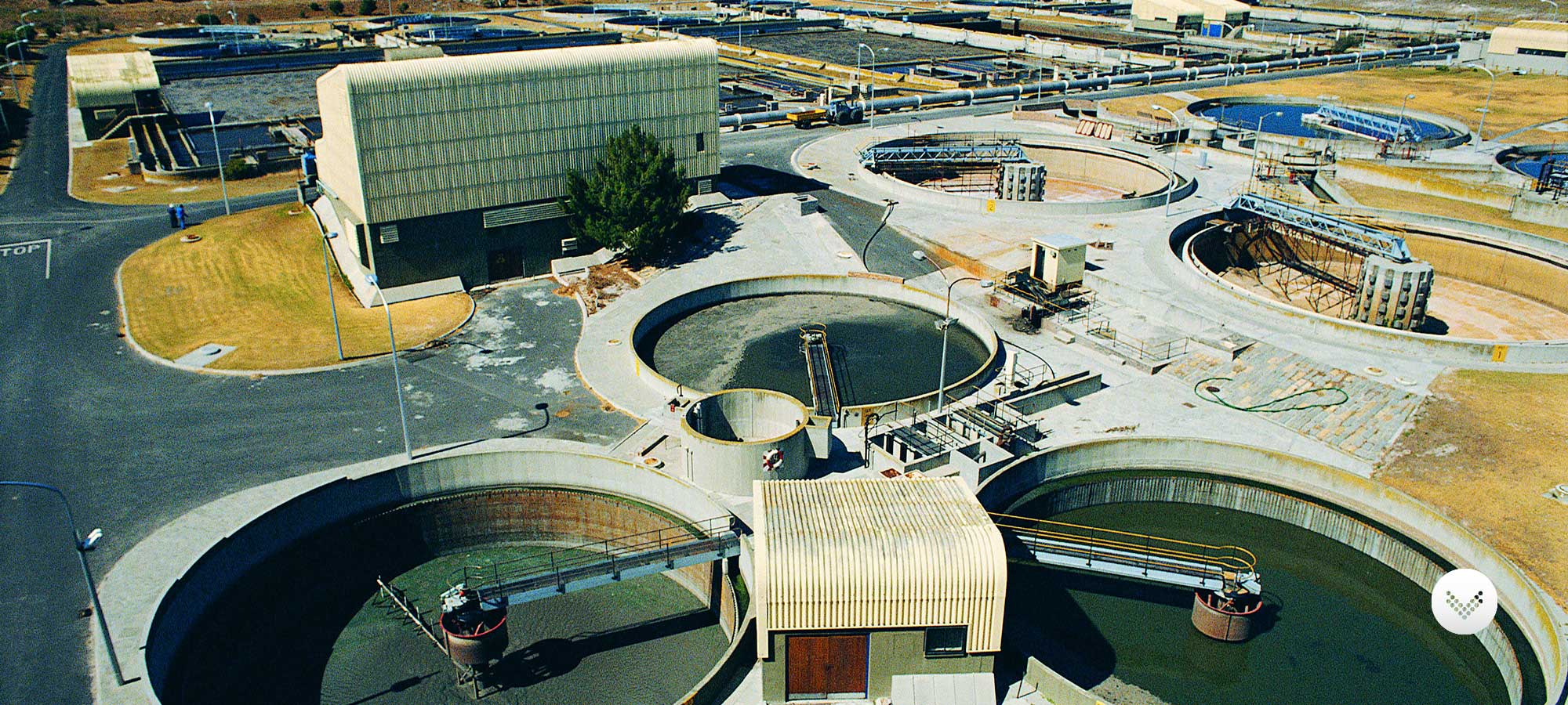 Waste water treatment plant seen from an aerial view featuring multiple collection pools.